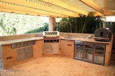 outdoor kitchen with granite benchtops and rhino bar fridge