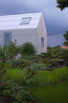 Summer House by Jarmund / Vigsnaes - nice contrast of clear wood and steel facade