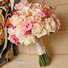 Ivory and shades of pink floral wedding bouquet