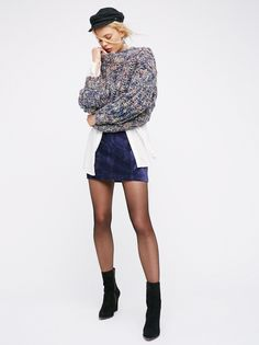 Modern Femme Velvet Mini Skirt   In a clean and sophisticated silhouette this velvet mini skirt is easily dressed for a night our or down with a casual tee and sneaks. Back zip closure.