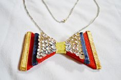 Chrissy Mae of The Classy Rugged Chick created this adorable bow-tie necklace from some old playing cards, felt, rhinestones, and ribbon! See how to create your own crafty necklace here!