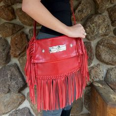 Red Lamb Leather Cross Body Purse with Hand Tooled Leather Designs, a Leather Fringe, and Hand Stamped Sterling Silver Concha Buttons. Leatherwork by Navajo Art