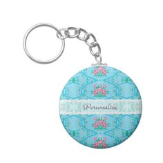 A chic and feminine pink and blue floral keychain with a vintage pink roses wallpaper pattern against an aqua blue floral background. Personalize this stylish vintage fashion accessory by adding your name. By: ©OhSoGirly