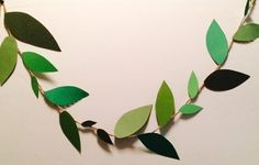 Rio inspired/ jungle themed leaf garand! Leaves made of 4 different shades of green construction paper. Very cute for a Rio party or jungle themed party!  Each foot of garland .50 cents 5ft $2.50 Measurements can be customized.