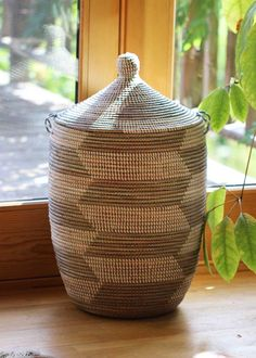 """Woven in rural Senegal, these large baskets are useful and beautiful in any home. The baskets are handmade from natural grasses and plastic strips, and measure up to 28""""H. Fair trade."""