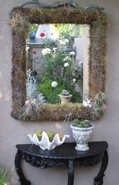 want to make this for the cabana I made this moss covered mirror for the entry just inside the gate several years ago. I hot glued floral foam onto an old mirror and covered it in moss. Then I wrapped the whole thing in chicken wire and used a staple gun to attach it to the wood frame. I attached tillandsias because they require minimal water.
