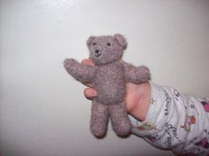 Hand knitted small Teddy Bear, with hand sewn face.  Please take a look at the items I sell @ www.lemayed-for-you.webs.com, thanks.