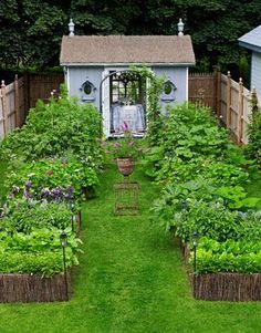What can be done with a small yard, a shed & creativity:  A prefabricated shed, customized with French doors & a roof that looks thatched. 2 architectural mirrors create a trompe l'oeil window effect.  4 raised, willow-trimmed beds filled with vegetables & flowers. Plot is just 25 feet wide x 120 feet deep. (Country Living)