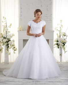 2517 Bliss by Bonny Bridal - Traditional modest wedding gown.  Ball gown skirt and cap sleeves.