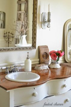 Bathroom vanity made from a repurposed vintage dresser.