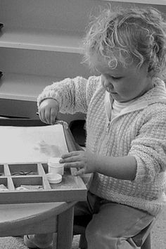 Montessori Art Toddler: Child pasting. Michael Olaf on Montessori Art through the different classes.