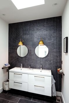 Love the floating cabinets for bathroom vanity / sinks, but a lighter backsplash / wall tile and bigger mirrors.