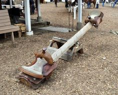 THIS IS AMAZING!!  I hope I can have it some day ;) Woah! Look at this Seesaw. Saddles as the seats are super interesting. Love it.