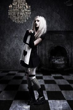 Goth Alice in Wonderland. Love it all. The white rabbit, the queen of hearts, the dark side of it all.