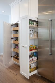 Kitchen Pull Out Pantry Kitchen Wall Fitted With White Shaker Cabinets Which Open To Reveal Slide Out Pantry Drawers And Pull Out Pantry Cabinet Alongside Kitchen Pantry Pull Out Wall Storage Cabinets, Kitchen Wall Storage, Kitchen Pantry Design, Kitchen Pantry Cabinets, Design Your Kitchen, Pantry Storage, Wall Pantry, Storage Hacks, Hidden Storage