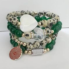STUNNING SET!! 8mm Dalmatian Jasper Beads 8mm Evergreen Jade Beads Gold Filled Our Father Prayer Charm Silver Filled, Cubic Zirconia Charm Mother Pearl Heart This is a cute set for any occasion and can be made to accommodate your wrist size. Make sure to specify your size at time of