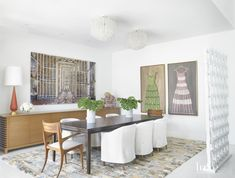 In the dining room, a Holly Hunt table joins Flexform side chairs and Blackman Cruz head chairs on a rug from ABC Carpet & Home. Jean-François Rauzier's artwork is from Waterhouse & Dodd via Pulse Miami Beach, and Manu's acrylic dresses are from Ercole Home in New York.