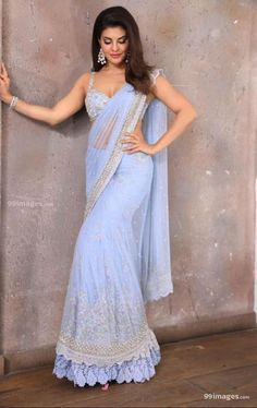 Jacqueline Fernandez Stills in South Indian Traditional Transparent Blue Saree and sleeveless blouse - Bollywood Hollywood South Indian Actress Gallery Lehenga Designs, Saree Blouse Designs, Jacqueline Fernandez, Bollywood Girls, Bollywood Fashion, Bollywood Celebrities, Bollywood Actress, Bollywood Saree, Indian Wedding Outfits