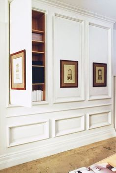 Inspiration ~ Hidden bookshelves behind panels