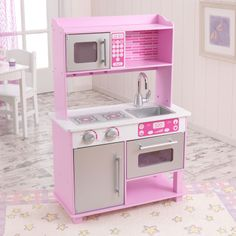 25.25L x 12W x 36.75H inches  Kidkraft Pink Toddler Play Kitchen with Metal Accessory Set $109.98. Short on accessory storage, Shorter height.