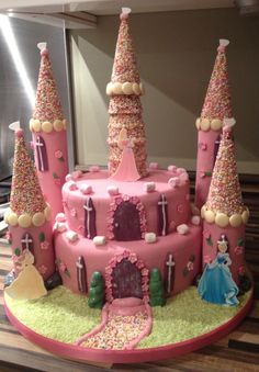 Princess Castle Cake comprising two deep tiers- chocolate fudge with choc fude buttercream and Madagascan vanilla sponge with strawberry jam and vanilla buttercream filling.