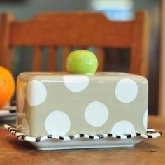 Pass the butter, please. Add some style and sophistication to your kitchen table with the  Neutral Dot Butter Dish.  It is microwave safe if the butter needs to be softened, and is dishwasher safe too.