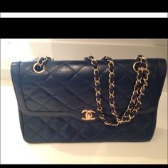 "Vintage CHANEL Flap Bag Serious buyers only for inquiring more information. This is my first CHANEL handbag & I am finally considering selling it as I have collected a few CHANELs along the years. Color is navy . Auth card is included. Minor to very gentle wear but well taken care of and was at the "" CHANEL spa "" a year or so ago and haven't used since .I will keep happily so please be mindful of comments .Check my sold handbag listings as I have sold dozens of my designer handbags here…"