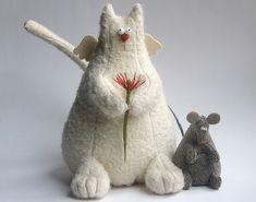 http://iztkanirukami.ru/cats/cat15.jpg  от мастеров Анны  Удаловой и Ольги Хлебниковой (IzTkaniRukami)