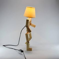 Little wooden design lamp in the form of a personage. this lamp has movable arms and legs so it can be placed in multiple positions. This funny lamp is perfect for in a kids bedroom. Each design is unique and the dimensions / finishes can vary slightly depending on the order.