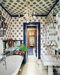 House of McNairy: Brandolini Style. I love Brandolini's interiors and have for years. The blue laquer trim and moldings, I'm crazy for it and the busy wallpaper in a small bathroom is perfect.