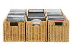 CD storage idea -- put covers and CDs/DVDs into plastic sleeves, store in long baskets