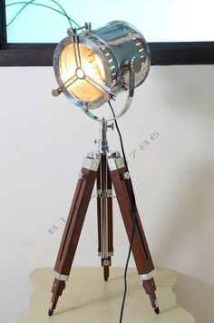 Nautical Vintage Industrial Theater Stage Spotlight Floor Lamp - Home Decor Industrial Marine Floor Lamp Mounted On Timber Tripod Stand by bluesky3786 on Etsy https://www.etsy.com/listing/195324314/nautical-vintage-industrial-theater