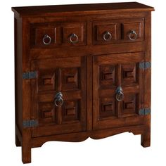 Inspired by the Lion Capital of Ashoka—an ancient sculpture and National Emblem of India—this cabinet has the look of a rustic antique. Its mango wood construction features lion's head hardware, carved panel doors and traditional, curved apron. The lower cabinet opens to reveal interior shelving and two upper drawers provide additional storage. Best of all, its slim profile means this design can stand guard in hallways, entryways or any place where room is tight.
