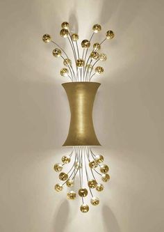 This beautiful and modern sconce lighting has been designed by Fisher Weisman. It has 32 asymmetrical rods of steel, topped playfully by crystal spheres and backlit upward and downward by LED or ha. Lounge Lighting, Luxury Lighting, Unique Lighting, Lighting Ideas, Bathroom Wall Sconces, Candle Wall Sconces, Wall Sconce Lighting, Powder Room Lighting, Modern Sconces