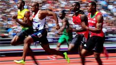 Usain Bolt of Jamaica and James Dasaolu of Great Britain compete in the Men's 100m, London 2012