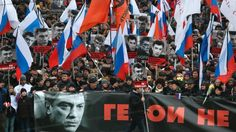It is not who killed V Nemtsov, but why?  Russians carry a huge banner reading 'those bullets for everyone of us, heroes never die!' as they march in memory of opposition leader Boris Nemtsov in Moscow on Sunday. Tens of thousands converged in central Moscow and Saint Petersburg to mourn the veteran liberal politician.