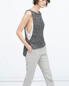 Bild 3 von Gemusterte Weste mit asymmetrischer Länge von Zara