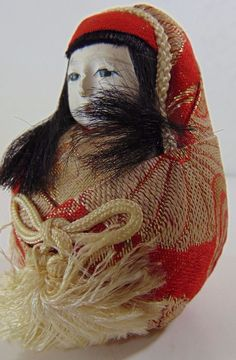 """.99 cent auction...known as the 'Friendship' doll from Japan,  circa 1930s or of the Japanese Showa period (1926-1989)   made of a 'gofun paste' and wood, this kimono wrapped baby doll is attributed to the artist Shundou, but there is no mark, at least visible.    She is a  little pale and has some crazing to her face. Measuring 3"""" tall, she has inset painted eyes and mouth."""
