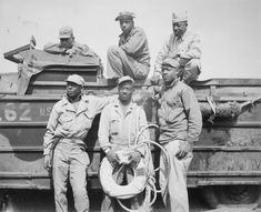 Seeking to rescue a Marine who was drowning in the surf at Iwo Jima, these six soldiers narrowly missed meeting their own deaths when their amphibian truck was swamped by heavy seas, 11 March 1945.    L-R, back row: T/5 L. C. Carter, Jr., Private John Bonner, Jr., Staff Sergeant Charles R. Johnson.   L-R, front row: T/5 A. B. Randle, T/5 Homer H. Gaines, and Private Willie Tellie