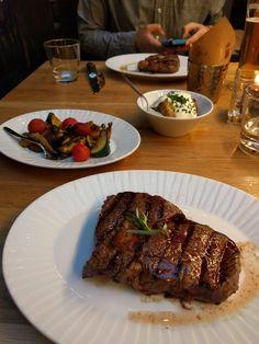 [I ate] ribeye steak vegetables baked potato steak fries