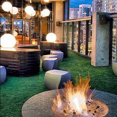 Fake lawn, built-in benches and firepit on roof garden // Vertigo Sky Lounge, Chicago