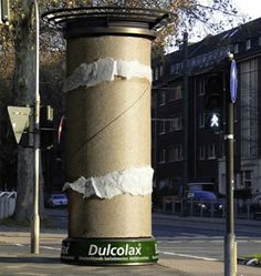 In Dusseldorf, Germany, ordinary pillars were turned into giant toilet paper rolls for laxative drug Dulcolax.
