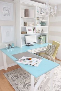 Home office space to spark creativity. Beautiful chandelier, subtle stripe wall, turquoise desk top - love it all!