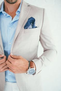 Something as simple as teaming a beige check blazer with white casual pants can potentially set you apart from the crowd. Shop this look on Lookastic: https://lookastic.com/men/looks/beige-blazer-light-blue-long-sleeve-shirt-white-chinos/20927 — Light Blue Long Sleeve Shirt — Navy Floral Pocket Square — Beige Check Blazer — White Chinos
