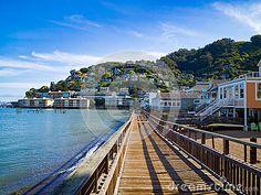Boardwalk leading to a seaside town over looking the bay.