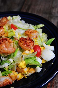 Blackened Shrimp Salad Recipe:: 2 lbs blackened shrimp, 1 head iceberg lettuce, 6 hard-cooked eggs, 8-10 pieces cooked bacon, 8-10 green onions, 1 pint grape or cherry tomatoes, 1 (8-oz) package cheese