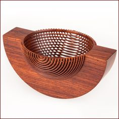 """Bordering on the impossible"".  Rocking bowl in cocobolo by Hans Weissflog."