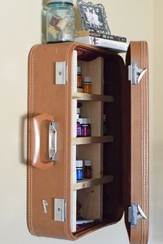 How to take a vintage suitcase and create a DIY vintage suitcase cabinet for storage or home decoration. I needed either an essential oils case or a place for essential oils storage, and this is perfect! It definitely adds character to our living space… the stories that old suitcase could probably tell.