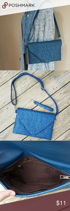 "Blue Textured Crossbody/Wristlet NWOT blue purse is perfect for Spring! Comes with wristlet strap. Gold hardware, brown fabric interior and snap closure.  Measures 11.5"" across and 8"" high. Large Strap adjusts from 49"" to 26.5"". Unbranded Bags Crossbody Bags"