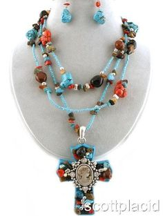 "CHUNKY MULTI STRAND RECONSTITUTED TURQUOISE AND MIXED STONE CHIP 3"" LONG AND 2.5"" WIDE CROSS CHARM NECKLACE SET WITH CRYSTAL ACCENTS    * If you need a necklace extender I have them for sale in my store.*       NECKLACE: 18"" LONG +3"" EXT                HOOK EARRINGS                    COLOR: TURQUOISE AND SILVER TONE  $21.99"